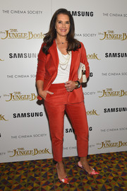 Brooke Shields looked smart in a red velvet pantsuit during the screening of 'The Jungle Book.'