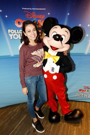 Mila Kunis attended the 'Disney on Ice: Follow Your Heart' event wearing a Junk Food 'Wonder Woman' sweatshirt.