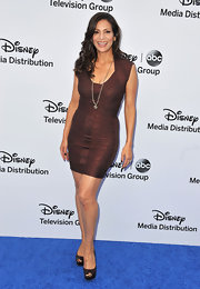 Constance Marie showed off her curves with this sparkly burgundy bandage dress.