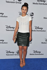 Hannah Ware's black mini skirt was an edgy addition to her white knitted sweater.