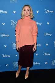 Kristen Bell looked ready for fall in a coral cashmere turtleneck by Sally LaPointe at the Disney Studios Showcase Presentation during D23 Expo.