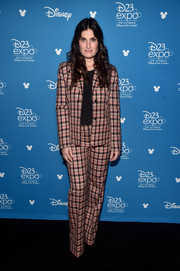 Idina Menzel attended the Disney Studios Showcase Presentation at D23 Expo wearing a pink plaid pantsuit.