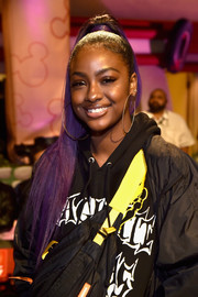 Justine Skye styled her purple tresses into a sleek, high ponytail for the kickoff of the 'Mickey the True Original' campaign.