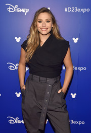 Elizabeth Olsen teamed an asymmetrical black top with gray harem pants, both by Proenza Schouler, for Disney's D23 Expo 2017.
