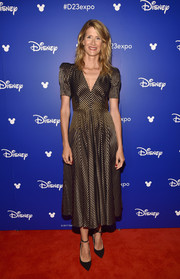 Laura Dern channeled the '40s with this gold and black striped midi dress by Bottega Veneta during Disney's D23 Expo 2017.