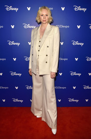 Gwendoline Christie went menswear-chic in a cream-colored pantsuit by Bella Freud for Disney's D23 Expo 2017.