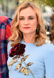 Diane Kruger wore her hair in casual curls when she attended the 'Disorder' photocall.