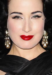 Dita Von Teese kept her glamorous signature style for the launch of the my Cointreau travel essentials event. Her black liquid liner, ultra long false lashes and luscious ruby lips always make a statement.