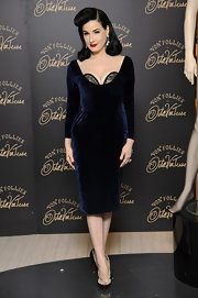 Dita brought her usual bombshell pin-up glamour to the launch of her new lingerie collection. We adore this velvet navy number!