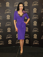 Dita topped off her sexy look with embellished peep-toe pumps.
