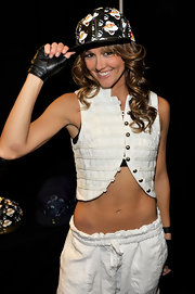 Sharni shows off her abs in a short white vest for the Celebration of Dance event.