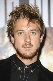 Arthur Darvill worked the red carpet with his hair in a messy style that still showed off his dashing good looks.