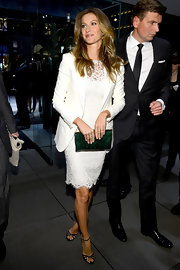 Gisele kept her look crisp and chic with a white lace frock and white blazer.