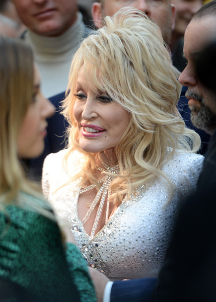 Dolly Parton Layered Cut [dolly parton,9 to 5,the musical gala evening - arrivals,the musical,hair,face,blond,hairstyle,lady,beauty,yellow,fashion,long hair,layered hair,the savoy theatre,england,london]