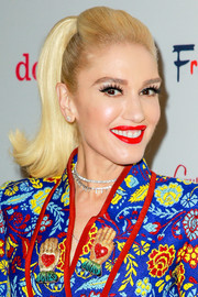 Gwen Stefani paired a bright red lip with a multicolored floral suit for a totally peppy look.