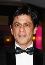 Shahrukh Khan topped off his elegant look with a sleek side-parted hairstyle at the premiere of 'Don - The King is Back.'