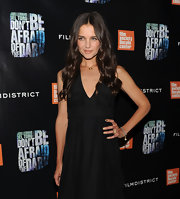 Katie Holmes opted for a LBD for the premiere of 'Don't Be Afraid of the Dark.' She finished off the look with loose shiny curls and gold nails.
