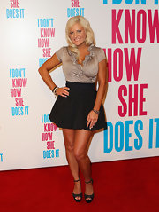 Brynne Edelsten showed off her super tanned legs in a black high-waist mini skirt.