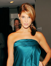 Ashley Greene rocked a sleek ponytail with side swept bangs at the Donna Karan fashion show.