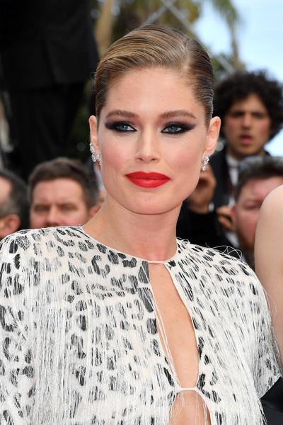 Doutzen Kroes Classic Bun [hair,face,lip,eyebrow,hairstyle,fashion model,fashion,beauty,skin,chin,doutzen kroes,once upon a time in hollywood,screening,cannes,france,red carpet,the 72nd annual cannes film festival,cannes film festival]