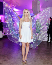 Dove Cameron styled her LWD with metallic pink peep-toe mules by Giuseppe Zanotti.