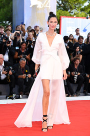 Bianca Balti looked exotic in a kimono-inspired white wrap dress by OVS at the Venice Film Festival opening ceremony.