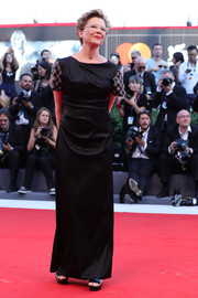 Annette Bening chose a draped black Giorgio Armani gown with embellished sleeves for the Venice Film Festival opening ceremony.