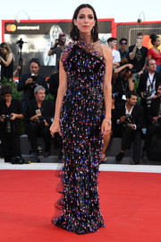 Rebecca Hall kept it fun yet glam at the Venice Film Festival opening ceremony in an Armani Privé asymmetrical column dress rendered in black sequins and multicolored dangling paillettes.