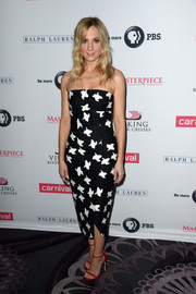 Joanne Froggatt injected a welcome pop of color with a pair of red slim-strap sandals.