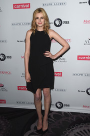 Laura Carmichael completed her minimalist ensemble with black PVC pumps by Nicholas Kirkwood.