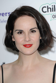 Love that bold red color Michelle Dockery chose for her lips!
