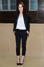Michelle Dockery kept it relaxed yet stylish in a satin-trimmed black pantsuit at the 'Downton Abbey' press launch.