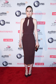 Michelle Dockery paired her frock with black patent pumps.