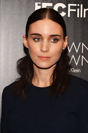 Rooney played with textures by opting for a shellacked half updo that led into cool bushy waves.