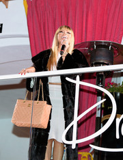Nicki Minaj paired a Chanel quilted bag with a fur coat for total glamour at the Drai's Beach Club New Year's Eve celebration.