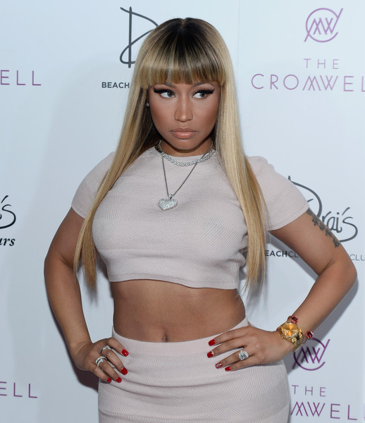 For a spot of color to her neutral outfit, Nicki Minaj wore sexy red mani.