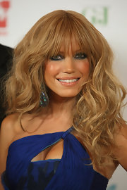 Sylvie van der Vaart pulled off an amazing look with her hair in long voluminous waves with added bangs.