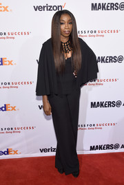 Estelle looked diva-ish in a caped black jumpsuit at the Dress for Success 20th anniversary gala.
