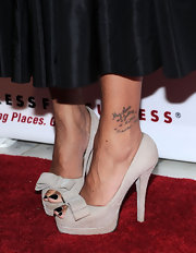 Misa Hylton Brim showed off her black pedi with this pair of nude platform pumps with a stylish bow detail.
