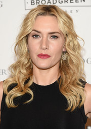 Kate Winslet wore her hair just past her shoulders in a glamorous curly style during the New York screening of 'The Dressmaker.'