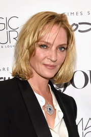 Uma Thurman sported a messy bob during her DuJour cover celebration.
