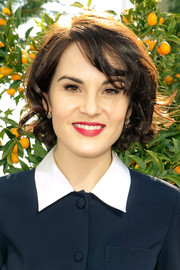 Michelle Dockery polished off her look with a sweep of red lipstick.