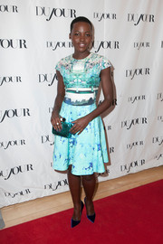 Lupita Nyong'o chose a fun-looking green polka-dot clutch by Sophia Webster to complete her ensemble.