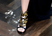 Khloe Kardashian wasn't afraid to make a statement with these gold and black sandals.