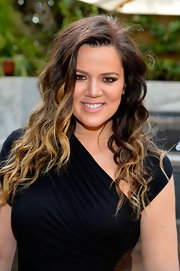 Khloe Kardashian looked as if she stepped right out of the sun at DuJour Magazine's Spring issue celebration. The reality star sported a beachy waves and a cool ombre shade at the event.