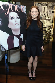 Julianne Moore opted for a long-sleeve snakeskin printed drop-waist dress for the celebration of her cover of 'DuJour.'