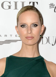 Karolina Kurkova wore her hair in a sleek side-parted bun at the Art Basel kickoff party.