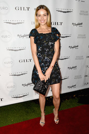 Petra Nemcova looked summery in a printed mini dress with a ruffle yoke at the Art Basel kickoff party.