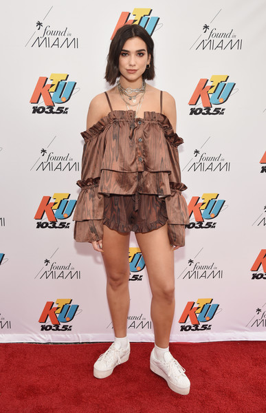 Dua Lipa Leather Sneakers [clothing,fashion,hairstyle,footwear,carpet,street fashion,yellow,flooring,brown,red carpet,ktuphoria - arrivals,ktuphoria,wantagh city,ktu,dua lipa]