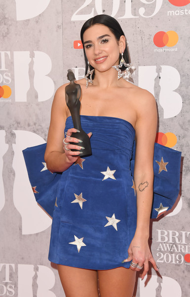 Dua Lipa Diamond Ring [clothing,dress,strapless dress,premiere,fashion,cocktail dress,leg,long hair,electric blue,fashion model,brit awards,dua lipa,room,winners room,england,london,the o2 arena]